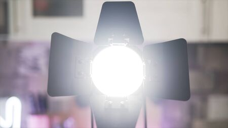 Close up of hands touching blades of tracking light. Male hands making diffused light instead of spot light, electric illumination of the room. Imagens