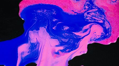 Beautiful mixing of blue and pink colors. Stock footage. Artistic background with mixing in stream of bright colors on black surface. Fluid art. Imagens