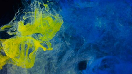 Smoky splash of color in water. Stock footage. Colored ink or acrylic paint in water creates beautiful smoky shapes. Underwater art.