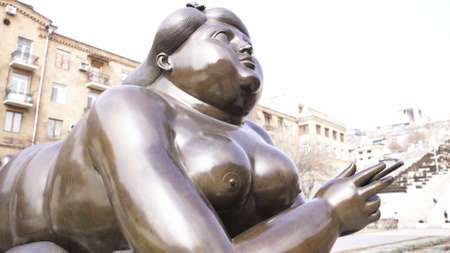 The sculpture named Smoking Woman, bottom view, Yerevan, Armenia. Art. Close up of the monument of a female lying and holding a cigarette, concept of art and architecture. Stock Photo