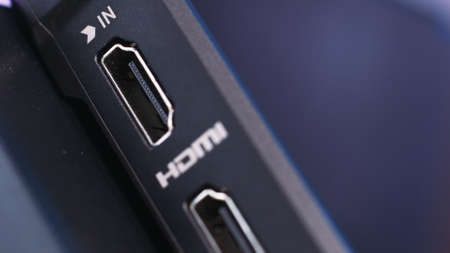 Close up of the external power and HDMI connector. Action. Side view of a computer or laptop device, modern technologies concept. Stock Photo