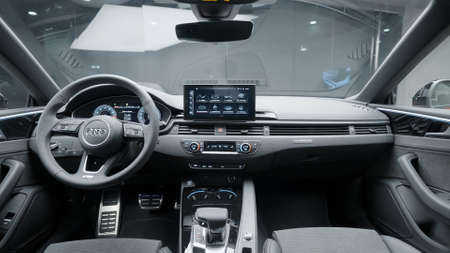 Germany, Berlin - March 2021: Modern black interior of new car. Action. Stylish and improved interior of new car from Audi. Latest design and technology in car interior