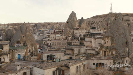 limestone caves and houses, Cappadocia, Turkey. Action. Breathtaking natural mountains and ancient architecture.