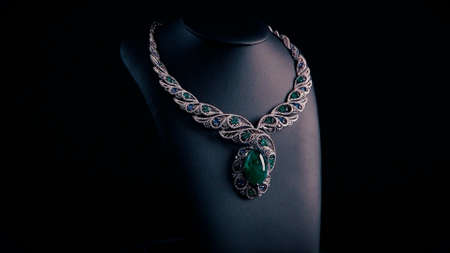 Beautiful necklace with blue sapphires and green emeralds on a black mannequin. Video. Close up of an expensive pendant of white gold and gemstones. Stok Fotoğraf