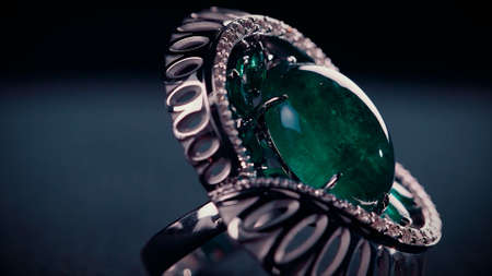 Close up of a silver ancient ring with a big emerald. Video. Amazing retro ring, historical jewel isolated on dark background. Stok Fotoğraf
