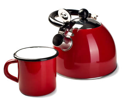 Teapot and a mug of red color isolated on a white background photo