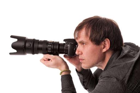 Jonge mannen met een digitale camera