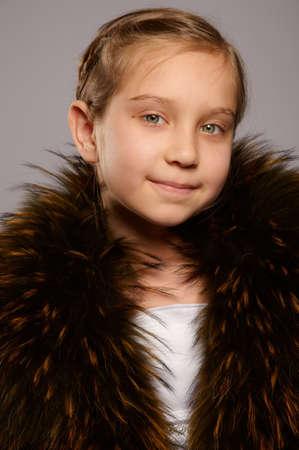Smiling girl blonde in fur coat