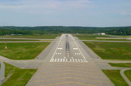 Airport runway on landing approach. Taken from cockpit of small private plane. Stock Photo