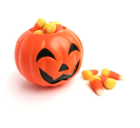 A plastic pumpkin filled with candy corn. Stock Photo - 3402425