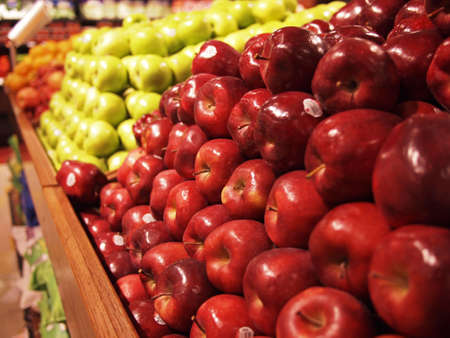 red apples: A row of stacked apples at the market. Stock Photo