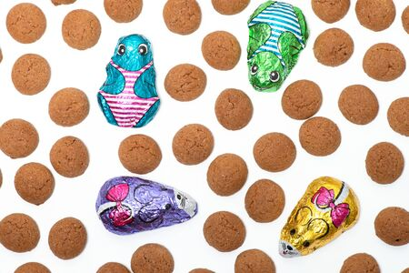 Background of ginger nuts ans sweets. Candy at Dutch Sinterklaas, chocolate mice and frogs, isolated background