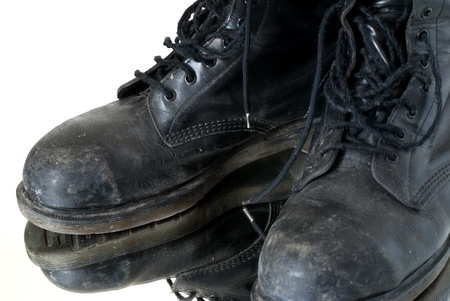 combat boots: Combat boots worn over a mirror Stock Photo