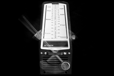 Mechanical metronome working with black background Stock Photo - 17334734