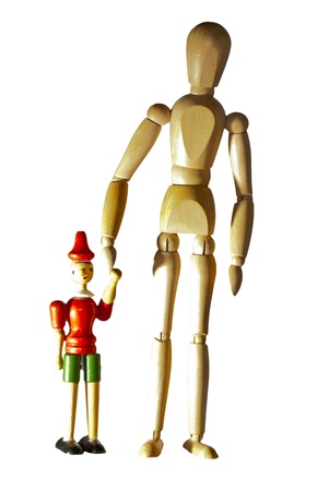 Couple of wooden dummies walking hand in hand Stock Photo - 18133262