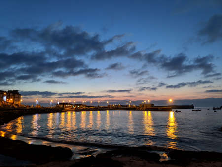 A beautiful nightfall at the sea port Foto de archivo