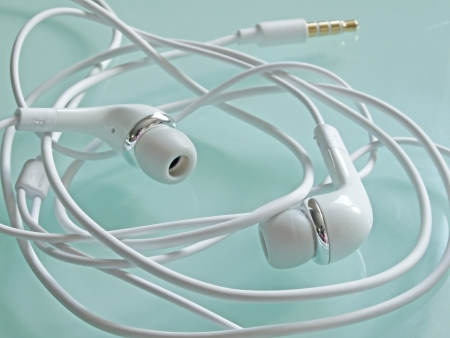 Wrapped earbud headphones