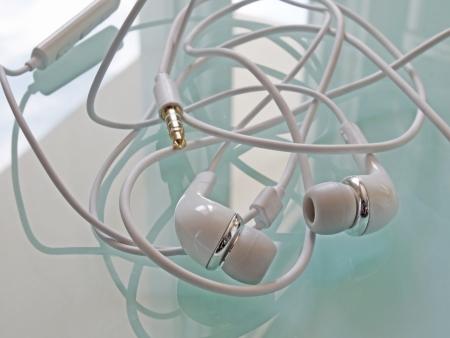 earbud: Wrapped earbud headphones