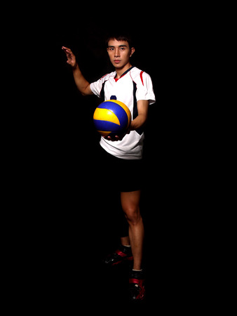 exert: Asian Volleyball Player Stock Photo