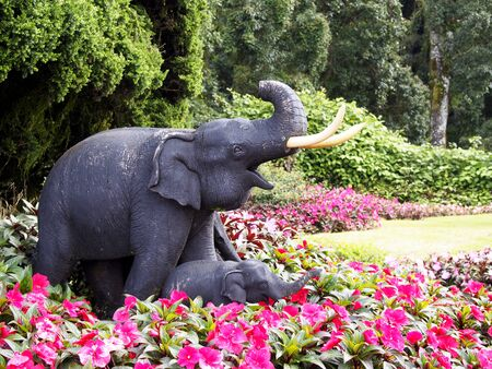 Elephant sculpture in the flower garden photo