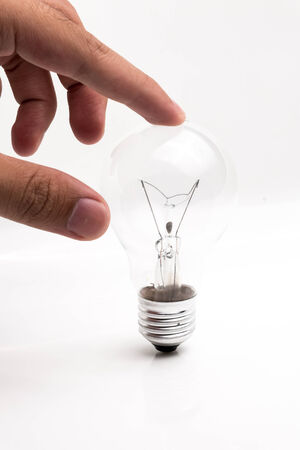 incandescent: Incandescent lamp in hand