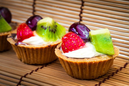 Mini fruit tart and wooden background photo
