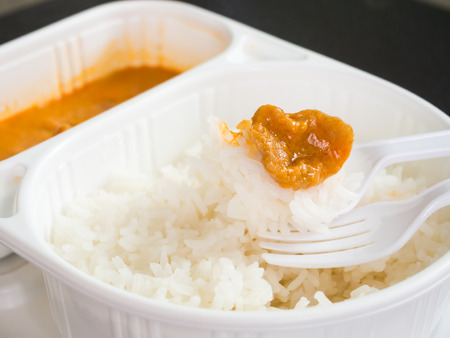 Rice and curry in the meal box set Stock Photo
