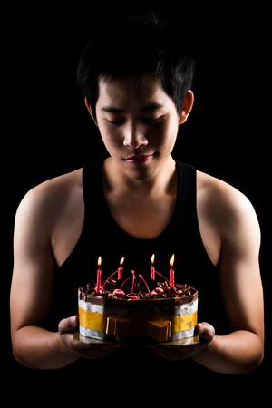 Asian boy with birthday cake photo