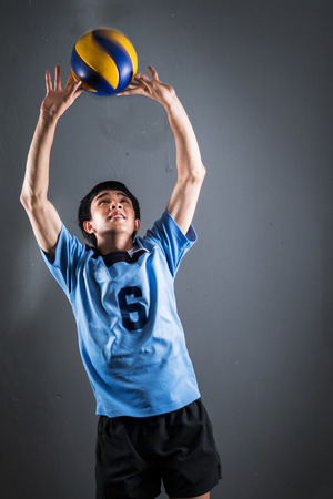 Asian volleyball athlete in action photo