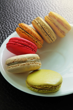 Colorful Macarons in the dish photo