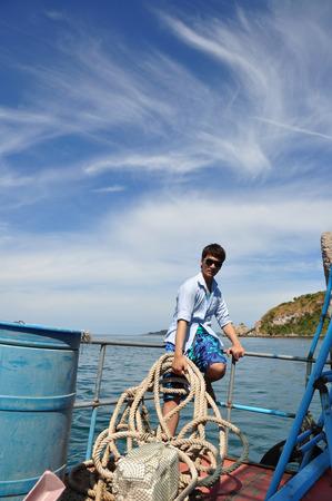 Asian man portrait in fisherman looks photo