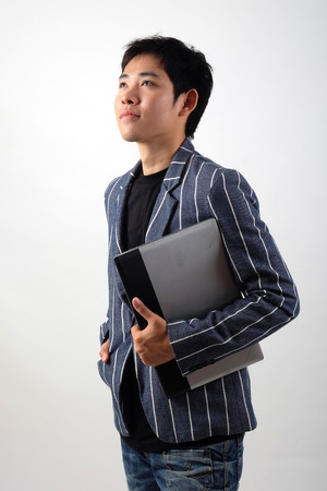 Asian businessman with laptop photo