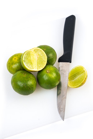 Limes on the white background photo