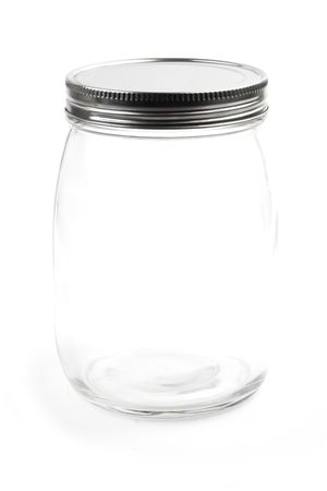 Empty glass canister in white background