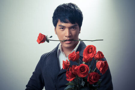 Asian guy with red roses in retro style