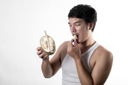 Asian man eating Durian