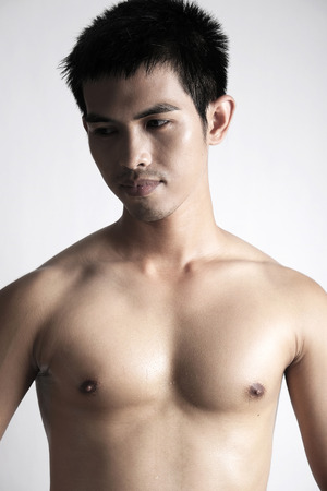 asian abs: Portrait of Asian male model shirtless