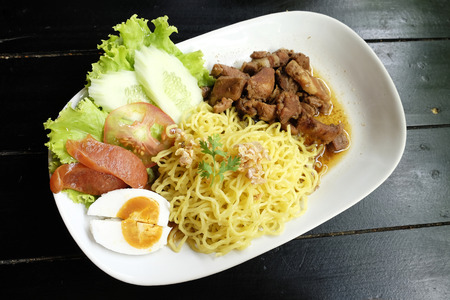 dry sausage: Dry Yellow Noodles with egg, salad, sausage and braised pork Stock Photo