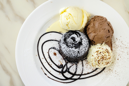 recipe decorated: Chocolate lava cake with ice-cream in the dish