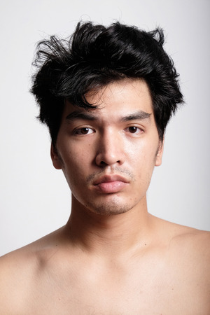 nude male body: Headshot of Asian man face with no makeup