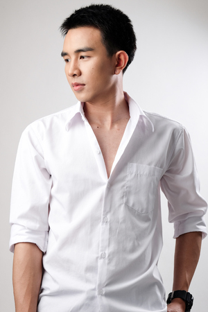 male fashion model: Asian man wear shirt in white background