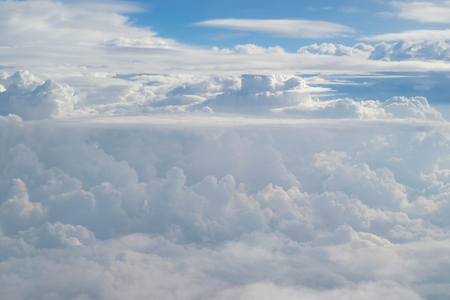Aerial view from the plane of fluffy rain cloud in daytime - Cloudscape