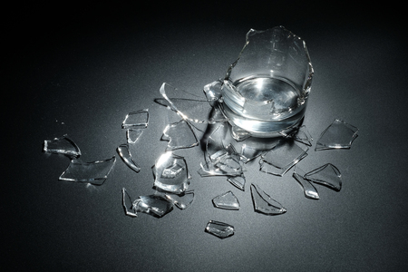 breaking: A breaking glass of water on the black background
