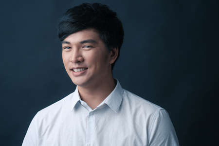 Studio portrait of Asian man on black background Stock Photo