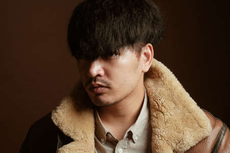Asian man portrait in vintage hipster style - Studio