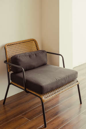 Wooden armchair with steel structure