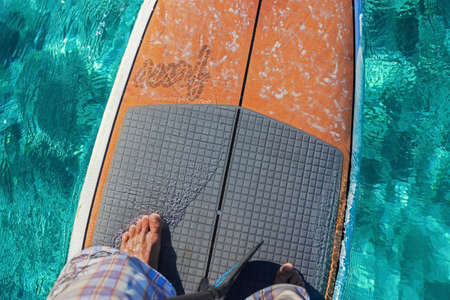 onboard: Onboard view on a stand up paddle board