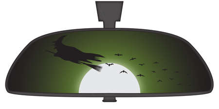 rear view mirror: Halloween witch in car rear view mirror isolated on a white background