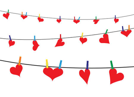 hung: Hearts hung on a washing line with pegs on a white background