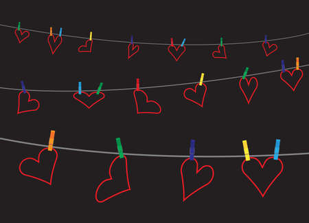 hung: Hearts hung on a washing line with pegs on a black background